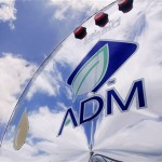 In this photo taken July, 2009, the ADM logo is seen on a tanker truck which carries mostly corn syrup at the Archer Daniels Midland Company plant in Decatur, Ill.  Agribusiness conglomerate Archer Daniels Midland Co. announced plans Wednesday, Jan. 11. 2012 to cut 1,000 jobs, or about 3 percent of its total workforce, with the majority of the positions being salaried staff.   (AP Photo/Seth Perlman)