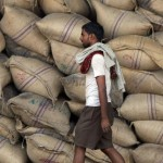 A labourer walks past sacks of sugar at a warehouse in Mumbai on April 21, 2008.  India's battle against spiralling inflation is not over yet, but more monetary tightening could put the brakes on growth in Asia's third-largest economy, analysts have warned.  The central bank has told commercial banks to hike cash reserves to suck out excess money supply in an effort to cool inflation that has more than doubled in four months to touch a three-year high of 7.14 percent.  AFP PHOTO/ Indranil MUKHERJEE (Photo credit should read INDRANIL MUKHERJEE/AFP/Getty Images)